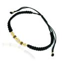 Złota bransoletka na czarnym sznurku